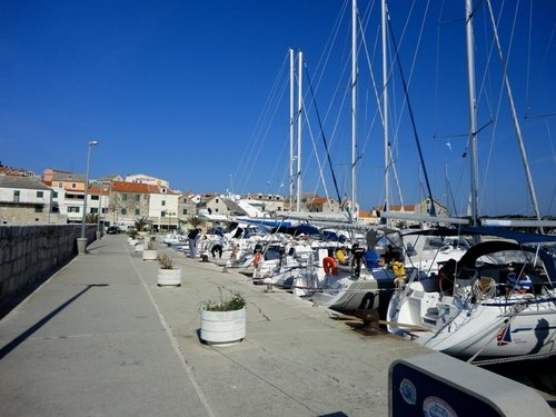 Typical Dalmatian village with a small port with moorings